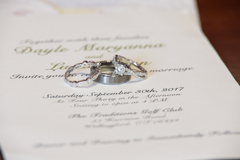 Wedding rings and invitation for getting ready shots